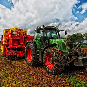 Image of a green tractor in a field
